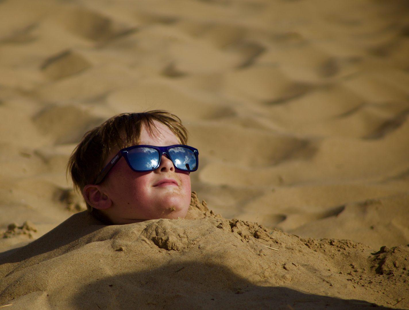 boy beach sand fun